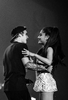 Justin surprised Ariana at her concert.. They sang 3 songs together.