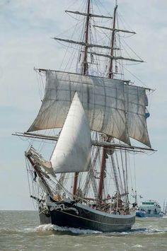 Well-rigged brig running home under topsails.