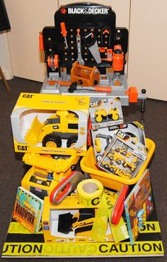 Construction Zone 2011 Bountiful Baskets Silent Auction Estimated Value: $200 CAT Delta Loader CAT Rugged Mover CAT Mini Mover CAT Mini Machines- set of 5 CAT Rumbling Big Builder CAT Megablocks Dumptruck Wader Construction Wheel Barrow Roadwork Book Black and Decker Workstation Handy Manny Let's Build It Play-a-Sound Book