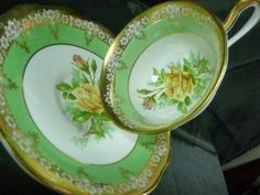 ROYAL ALBERT FANCY TEA CUP AND SAUCER YELLOW PEACE ROSE GREEN BAND GOLD TRIM