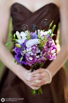 Bridesmaid with chocolate brown dress and purple themed bouquet: this is such a classy color combo!