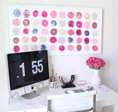 LOVE an all white workspace with a pop of color. Keeps everything looking clean so you can get things done! #greatoffice