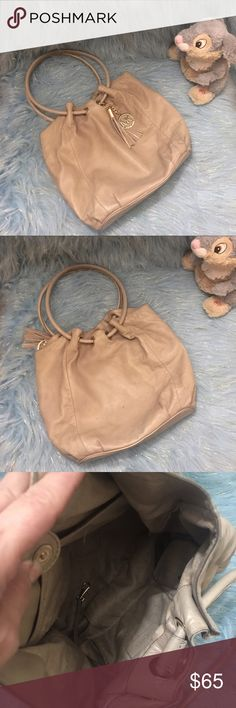 Michael Kors bag Super soft taupe leather bag. Has some pen marks interior and some marks and wear exterior. MICHAEL Michael Kors Bags Shoulder Bags