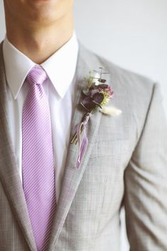 The groom's boutonniere is one of the few accessories for the groom. The small boutonniere declares the identity of the groom. The groom's boutonniere should be based on simplicity and smallness. Remember, the boutonniere and Read more… Groomsmen Attire Grey, Purple Groomsmen, Groom And Groomsmen, Groom Attire, Lavender Boutonniere, Groom Boutonniere, Succulent Boutonniere, Lilac Wedding, Wedding Colors