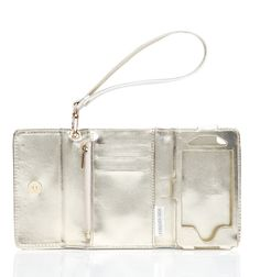 wristlet that holds everything in one place! Opens with a bow!