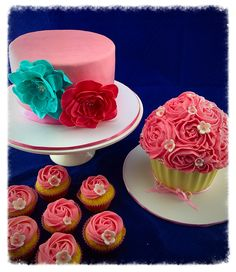 1st birthday cake with ruffle flowers, giant cupcake smash cake and cupcakes with buttercream rose swirls