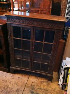 This is a lovely old glass door cabinet. It's in great condition and will be freshly waxed. Has some lovely carvings. Free local delivery.