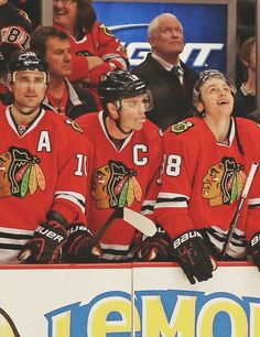 sharpie ( waiting), tazer (watching game), and kaner (watching something funny thats playing on the scoreboard)