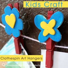 Clothespin art hangers painted with Plaid paint