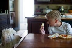 A boy and his dog at dinner Goldendoodle Lifestyle boys