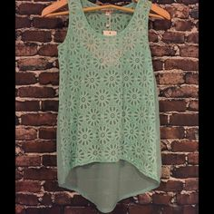 ⚓️️Floral High-Low Tank in Mint⚓️ 100% Polyester with rhinestone embellishment on the front. Dry Clean Only. This tank is adorable, pictures don't do it justice! Available in S,M and L. Also available in Mint, Pink and White. Could be used as a bathing suit cover-up or dressed up for a night on the town. Tops Tank Tops