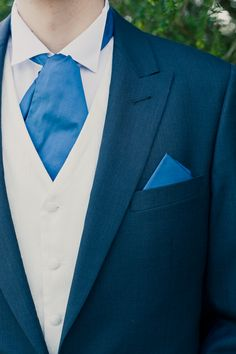 I like this for the groom. But maybe a silver tie. (if the suit is dark blue like i think it is)