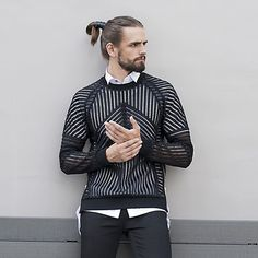 Our mesh sweatshirt in black or white, show off some skin or wear on top of crisp white shirt for added contrast.