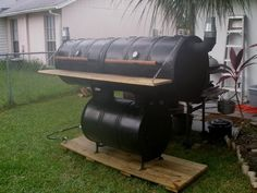 Homemade Smoker  Double Drum Cooking area and one on the bottom for burning trees!!