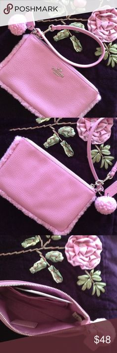 Authentic Coach Wristlet W/PomPom NWOT Cute Authentic pink Coach Wristlet with PomPom. Two card slots and coordinating lining. NWOT.   Leather care instructions included Coach Bags Clutches & Wristlets