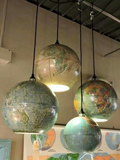 Recycled globes of the world as light shades