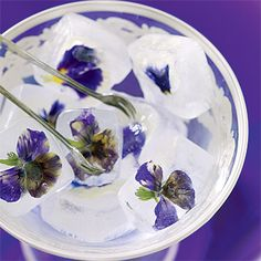 For a floral flourish, try freezing edible flowers (we used mini violas) with water in an ice-cube tray, then adding the colorful cubes to signature cocktails. Wineglass, Arte Italia, arteitalica.com. Floral design by Beautiful Blooms, beautifulblooms.com.