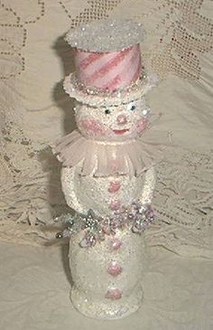 Twinkled Pink  An original paper mache snowman, I used the German glass glitter available from Little Pink Studio www.thelittlepinkstudio.com  Shines like nothing else!