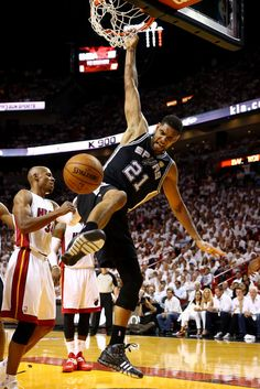 Tim Duncan Photos Photos - Tim Duncan #21 of the San Antonio Spurs dunks against the Miami Heat during Game Four of the 2014 NBA Finals at American Airlines Arena on June 12, 2014 in Miami, Florida. NOTE TO USER: User expressly acknowledges and agrees that, by downloading and or using this photograph, User is consenting to the terms and conditions of the Getty Images License Agreement. - NBA Finals: Game 4