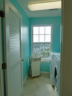 I'm certainly leaning towards aquas for the laundry room. It's cheerful and clean looking. Maybe the right shade will work with the sage in the kitchen