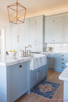Top designer tips for decorating your kitchen!    kitchen-white-marble-calcutta-gold-open-shelves-gold-black-vent-hood-blue-gray-cabinets-shaker-style-black-chevron-tile-subway-white-backsplash-decor-ideas-23-of-32