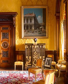 Gold damask and a boulle cabinet under a painting of Venice. Oh, and those doors. What's not to like?