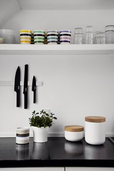 Kitchen counter at designers Jelena Schou Nordentoft and Ulrik Nordentoft home. w. stelton knives, kähler cups.