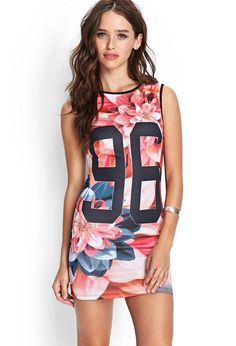 "A stretch-knit tank dress featuring an allover floral print and a number ""96"" graphic. Wear with ..."