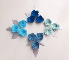 £7.75, 12 HAND CRAFTED WOOL BLEND SKY BLUE,CORNFLOWER,TEAL AND TURQUOISE COLOURED 3 D FLOWERS/ROSES IN 2 DIFFERENT SIZES. PLUS 12 FAUX LEATHER SILVER LEAVES.  THE FLOWERS ARE MADE FROM A 40% WOOL / 60% VISCOSE WOOL BLEND FELT.  YOU WILL RECEIVE 3 FLOWERS IN EACH COLOUR   THE FLOWERS MEASURE APPROXIMATELY 4.2CM X 4CM  THE FLOWERS HAVE BEEN GLUED WITH FABRIC GLUE.   COLOURS OF THE FELT: I have put a great deal of effort into taking images which represent the colours as closely as possible…