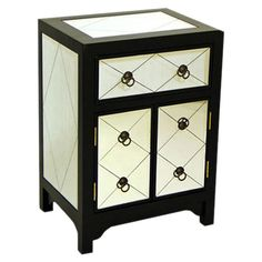 Hand-finished wood cabinet with one drawer and mirrored accents.   Product: Cabinet   Construction Material: Wo...