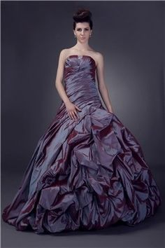 <p><strong>Description:</strong> Beautiful strapless taffeta dress, beaded and well ruffled. Fantastic plum dress for weddings, proms, quinceanera and sweet 16 receptions.</p> $277.00