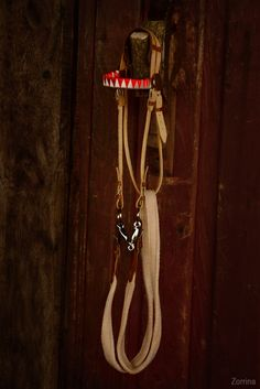 Mini decorative bridle. It's made of natural leather and metal accessories.