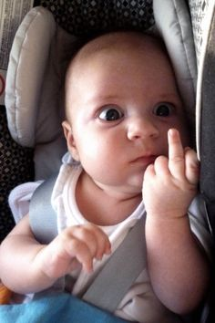 Newborn baby gives dad middle finger..