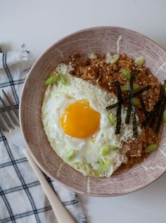 Fried rice always works best with rice that's a day old and sort of dried out. Add a fried egg and Kimchi for a filling Korean recipe.