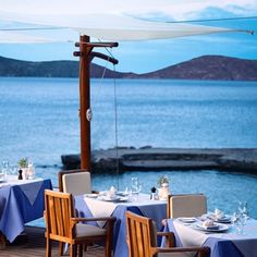 Lunch with a view. @mare_porto_peninsula in Crete Greece. #travelnoire #crete #eloundamare Looking for this view? Tag your travel partners! by travelnoire
