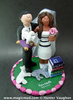 """mixed race wedding cake topper...is this a cute enough wedding keepsake?... this custom made creation features an exotic bride who loves to read and her fiance who also doubles as butler to their beloved  bijon dog...  whatever your situation it would be a pleasure to """"do your bidding"""" and sculpt a cake topper for a wedding, birthday,anniversary,graduation or any occasion $240 #wedding#cake#topper#custom"""