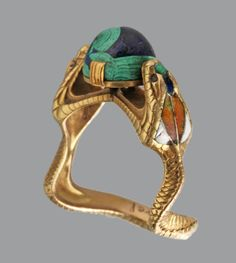 1900s art nouveau 18k gold hooded cobras holding the world - a crystal combination of lapis and malachite by charles boutet de monvel