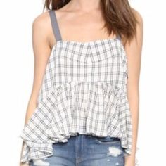 NWT Med. Free People Tank NWT....White and green plaid with adjustable straps Free People tank. Also has cut out on sides with straps. Super cute works for summer and winter! Dress it up with a kimono sweater and jeans and you would be ready for a day out. Free People Tops Tank Tops