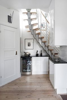 Scandinavian interiors - they sure know how to use every sq. inch of space. Like the stair design!