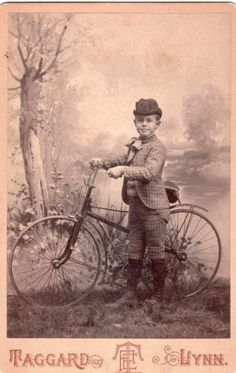 Little boy with his bicycle, antique Victorian cabinet card photo, 1880s.
