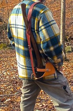 Sucks having to lug around your ax, while trying to use your hands for other things...  Check out how to make a hands-free system to hold your ax... So you can be all manly, and grow a beard and stuff... #camping