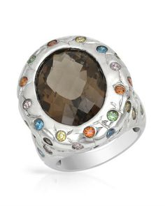 Cocktail ring with topaz and cubic zirconia