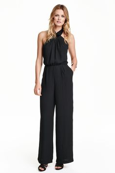 Halterneck jumpsuit: Backless jumpsuit in a lightly crêped weave with beading at the neck, ties at the back of the neck and a seam at the waist with box pleats at the front. Side pockets, wide, flared legs and a zip at the back. Unlined.
