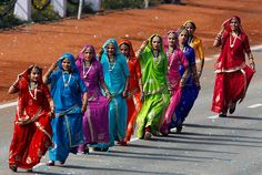 Indian women dance during the main Republic Day parade in New Delhi