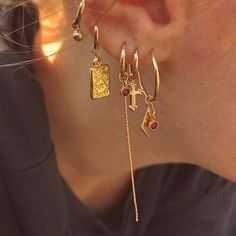 Love layered long earrings. It's important to make sure a piercing looks effortless and not painful.