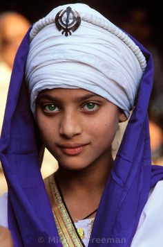 A young Sikh girl, Amritsar, India, during the annual procession of the Granth Sahib (the Sikh Sacred Book kept in the Golden Temple) around the city.. Michael Freeman