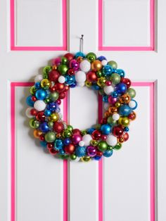 Create colorful accents on your front door with tinted tape, then finish with a merry ornament wreath.