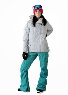 Whitney in a light grey ski jacket.