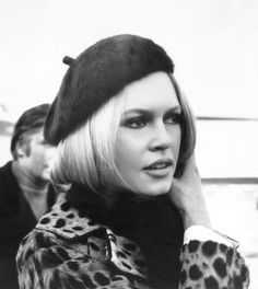 Brigitte Bardot sporting the quitessential 60s beret and leopard coat