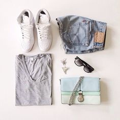 Grey v neck t-shirt,high wasted cut off blue jean shorts. The accessorizes are a nice touch,but I'd personally replace the shoes with a pair of white Keds or gladiators.